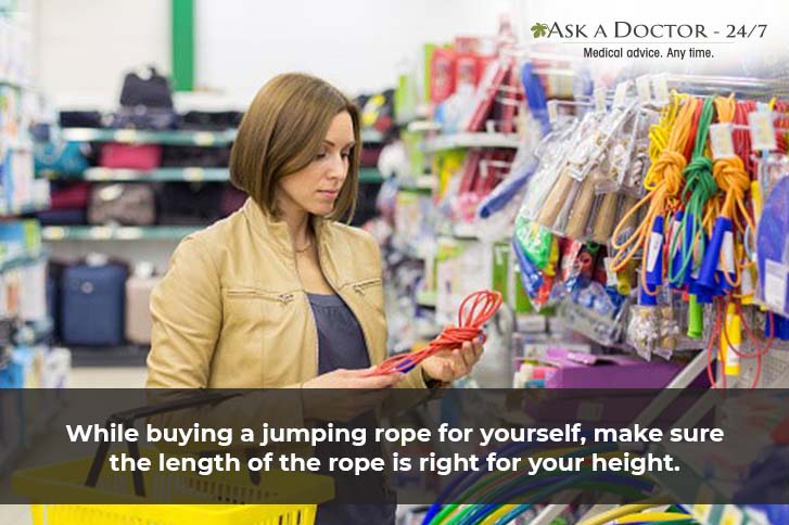 woman selecting and purchasing a jumping rope in a shop=