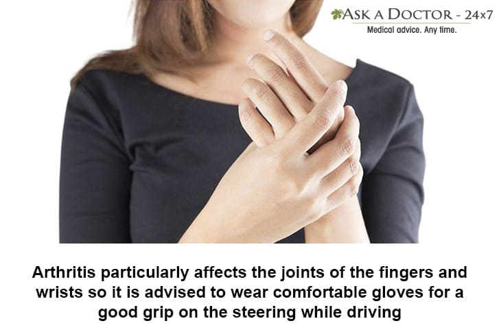 woman holding her righthand finger in pain=